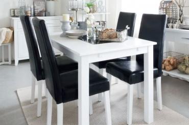 Matgrupp Bella med klaffar från serien Borlänge. Köksbord i vitt och granit med 4-8 stolar. Storlek: 140-240 cm.