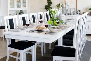 Matgrupp Olivia med klaffar från serien Orsa. Stort matsalsbord i vitt och granit med 8-12 stolar. Storlek: 240-349 cm.