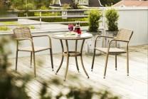 Möbelgrupp Pamplona. Bord med skiva i härdat glas, diameter 70 cm samt 2 stolar