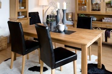 Matgrupp Benjamin med klaffar från serien Borlänge. Köksbord i oljad ek och granit med 4-8 stolar. Storlek: 140-190 cm.