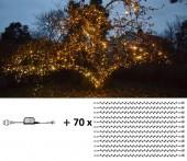 Maxpaket 6 - Komplett paket med LED-belysning som lindas tätt runt grenar och stam på träd.